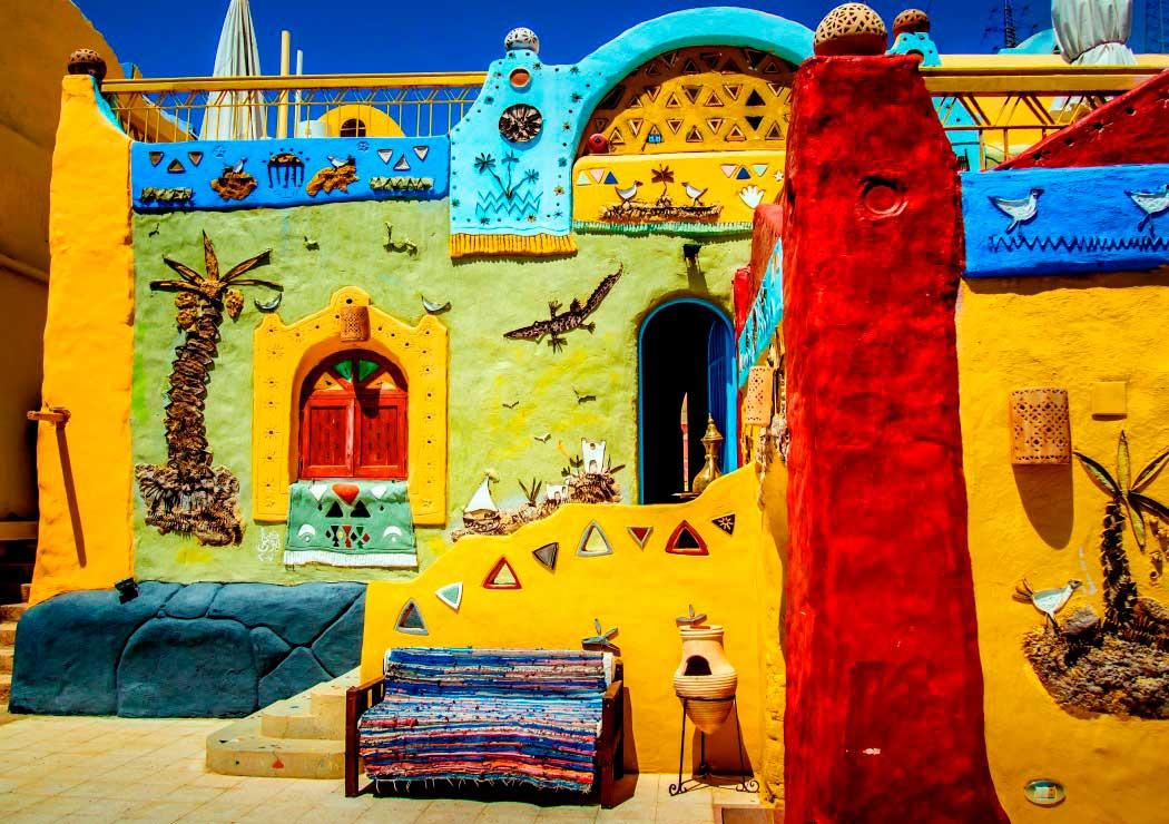 Puzzle Bluebird Pueblo Africano Colorido de 1500 Piezas
