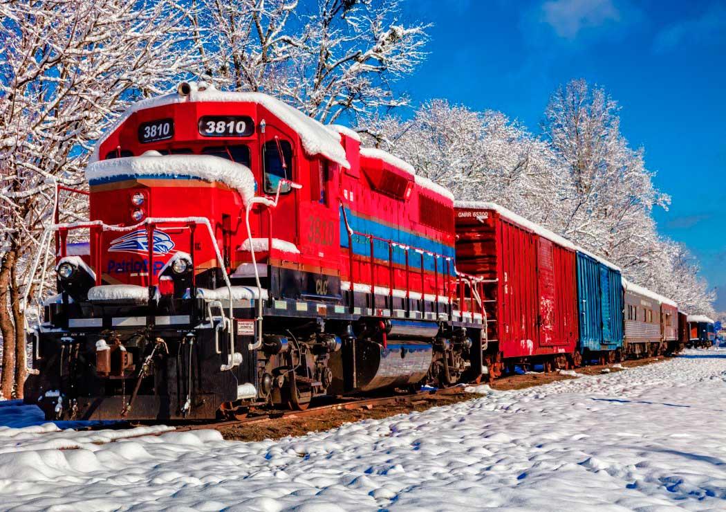 Puzzle Bluebird Tren Rojo en la Nieve de 1500 Piezas